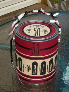 Stir up some fun with a can filled with gag gifts for the big 5-0.  See more 50th birthday gag gifts and party ideas at www.one-stop-party-ideas.com