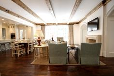 """Northway - traditional - family room - atlanta - Castro Design Studio, 20 ft wide, abt 40 ft kitchen to fp, 10 ft ceiling height, floor: 5"""" wide character grade red oak, couch is abt 14 ft from 52"""" tv; limestone mantel from Materials Marketing Atlanta, beams abt 6 x 6"""