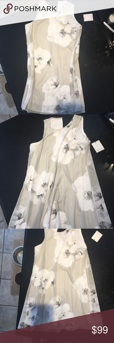 Calvin Klein Sheer lined flowered dress NWT sheer with lining floral Calvin Klein dress. Adorable fun and free flowing Calvin Klein Dresses Midi