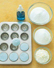 Bath Fizzies     •Baking soda   •Cornstarch   •Citric acid   •Spritzer bottles   •Food coloring   •Glass bowl   •Essential oil   •Baking molds