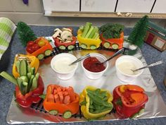 Healthy snacks for kids- veggie cars for party. Fill sliced peppers with veggies.