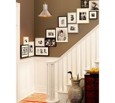 Family photo gallery wall is the best way to decorate the stairway