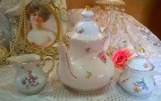 Very pretty large floral teapot with matching milk jug and lidded sugar bowl