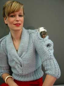 the 'hamster sweater' establishes a terrain where small rodents are free to burrow through a network of oversized cable-knit tunnels whilst remaining closely on your person.