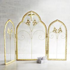 Handcrafted exclusively for Pier 1, our galvanized iron sheet backdrop comprises three arched panels with decorative scrolling. Painted gold with a star topping the middle panel, it will provide the perfect setting for your nativity figures. Hinged for versatility, it stores easily.