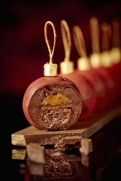 Bûche La Réserve Paris Hotel & Spa 2015 Plus - chocolate baubles with a mousse centre and clementine or salted caramel creme Xmas Food, Christmas Cooking, Christmas Desserts, Christmas Treats, Christmas Recipes, Mini Cakes, Cupcake Cakes, Christmas Log, Christmas Ornament