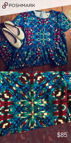LuLaRoe Amelia dress LuLaRoe Amelia dress. Super fun print! Almost tye-dye looking. Older print. Stretchy material. Worn twice, but in perfect condition. I wash all my clothes per LuLaRoe standards. Size small. Please see my closet for more LuLaRoe. LuLaRoe Dresses Midi