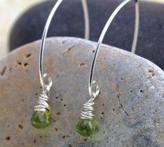 Amazing petite peridot - parrot green, micro faceted, gorgeous - is carefully wire wrapped in sterling silver. Ear wires are hand formed from