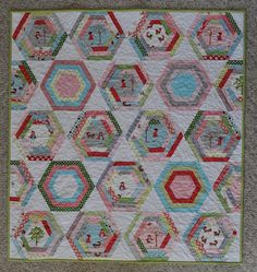Log Cabin Hexagon Quilt by TheSewingChick, via Flickr
