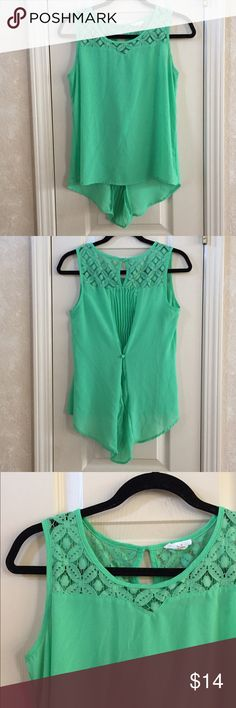 Green Tank Top Green lace tank top with hi-low hem. Pleated design in back. 100% polyester. Mine Tops Tank Tops