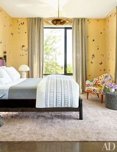 Playful de Gournay wallpaper lines a child's room in interior designer Sara Story's refined Texas retreat