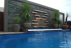 If you are working with the best backyard pool landscaping ideas there are lot of choices. You need to look into your budget for backyard landscaping ideas Modern Water Feature, Backyard Water Feature, Waterfall Landscaping, Backyard Landscaping, Outdoor Walls, Outdoor Pool, Swiming Pool, Swimming Pool Waterfall, Pool Water Features