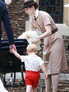 July 5, 2015 - Besides friends and relatives, the Cambridge nanny, Maria Teresa Turrion Borrallo in her Norland Nanny uniform, was in attendance to help with the baby and keep an eye on rambunctious toddler George.