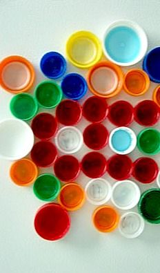 We had a large collection of plastic bottle tops of all sizes and colours which we thought would fit nicely into our shapes around us theme...