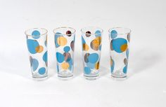 Home Style 1 / Mid-Century Modern Glassware: Vintage 50s RUSSEL WRIGHT Eclipse Water Zombie Glasses Mid Century Modern Gold Blue 4. $45.00, via Etsy.