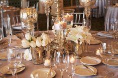 Different heights, mixing metals/glass. elegant ivory wedding flowers tulips lillies mercury glass 1. via Aileen Tran