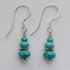 "Three sizes of faceted turquoise roundels with India sterling silver spacers. Sterling silver french hook ear wires. 1 1/2"" long."