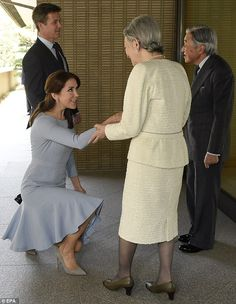 Formal greeting: The royals met theEmperor of Japan Akihito and Empress Michiko, with Mary curtsying