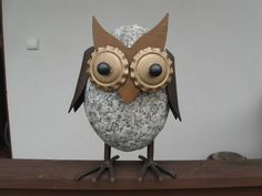 Owl made of stone and steel