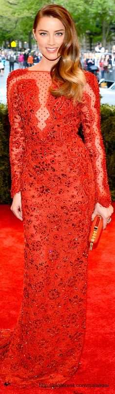 Met GALA 2013:   Amber Heard The dress: Red Emilio Pucci sequinned gown with sheer lace details