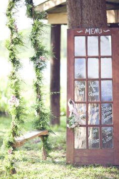 swing decorated with ferns and babys breath