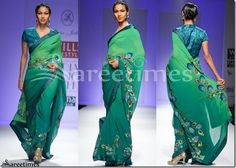 Model walks in beautiful green designer dual color georgette saree. Beautiful embellished patch work designs around it saree blouse. Embroidered sequins buttes through out border. Paired with designer backless collared sleeves saree blouse with 'V' shape collar neck pattern. Designed by Sonia Jetleay at Day 3 WIFW Autumn/Winter 2013.