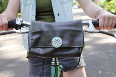 Create a front bike pouch to store your belongings while you cruise the streets in style.