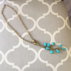 Gold tone & turquoise stone rope chain necklace. Gold tone and turquoise stone rope chain necklace. Can be worn several different ways. Total length of necklace is 41 inches. Worn once. Jewelry Necklaces