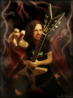 Darrell Lance Abbott, aka Dimebag Darrell, was an American guitarist and songwriter best known as a founding member of two bands, Pantera and Damageplan. He was shot and killed by a gunman while on stage during a performance with Damageplan on December 8, 2004, at the Alrosa Villa in Columbus, Ohio. He ranked No. 92 in Rolling Stone magazine's 100 Greatest Guitarists and No. 1 in the UK magazine, Metal Hammer. He was 38 years old. Washburn Dimebag, Metal Bands, Rock Bands, Dimebag Darrell Guitar, Vinnie Paul, Famous Guitars, Bass, Power Metal, Rocker