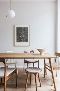 at home with avenue design studio. / sfgirlbybay modern wood dining table with mismatched wood chairs. Dining Room Inspiration, Interior Inspiration, Dining Room Design, Dining Area, Dining Table Small Space, Chairs For Dining Table, Modern Dinning Table, Eclectic Dining Chairs, Dining Stools