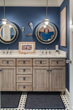 Coastal Style How to Get the Look ! Fun porthole mirrors add plenty of nautical style in this bathroom, along with the blue and white color scheme. Even the vanity takes on the color of soft driftwood. (www.town-n-country -living.com)