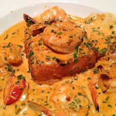 Crossroads Shrimp and Grits -- Our very own pan seared jumbo shrimp simmered in a chipotle garlic creme sauce, layered over a housemade crispy fried grit cake and served with sweet teardrop tomatoes Salmon And Grits Recipe, Salmon Recipe Pan, Shrimp And Grits Sauce Recipe, Cajun Recipes, Shrimp Recipes, Cooking Recipes, Cajun Cooking, Cajun Food, Bar Recipes