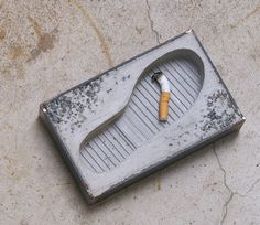Foot Ashtray, by Pull+Push - concrete with a (fake) footprint pressed into it.