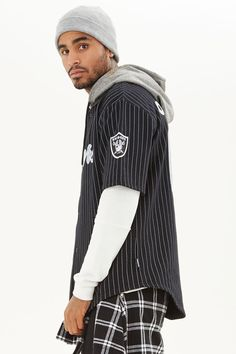 "From our NFL collection, this fleece knit pinstripe shirt is complete with a ""Raiders"" embroidery, ""Oakland 60"" back embroidery, button front, marled hood, and short sleeves with a helmet and team logo patches. style"