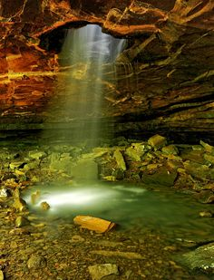 A waterfall shines through the top of a cave in Arkansas near Eureka Springs. Derek Ceola, Your Take