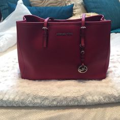 🎉HP💕 Michael Kors JetSet East West Large Tote Great condition. Authentic💯. Red with silver hardware. I do not trade!🙅🏻 Reasonable offers only! Please feel free to ask any questions before purchasing😊 there is a second listing with additional photos! I DONT TRADE.   Ⓜ️ Michael Kors Bags Totes