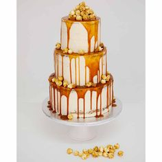 It wasn't that long ago that we gathered together the best drip wedding cakes for you, and now we've found one that combines the dreamy drip style with our new favourite semi-naked trend. The cake is mostly covered by a champagne coloured icing that's been very lightly spread with bits of the cake still showing. The addition of popcorn is just perfect and we can only imagine how incredible the cake tastes!
