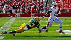 Norfolk State linebacker Deon King can't make a tackle Rutgers running back Savon Huggins. (Mel Evans/AP)