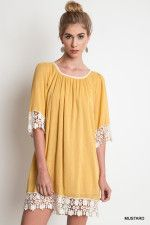 Fall must have in this gorgous mustard yellow and detailed in lace. www.laneylus.com