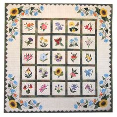 """P3-140 Wildflower Wall-Hanging. The Wildflower quilt is blooming with 25 different wildflower blocks. The blocks are set with 1"""" sashing, Sunflower & Morning Glory corner applique borders, and finished with a saw tooth border.  Pattern includes full size drawings for the 25 Wildflower 6"""" finished blocks, and border to make the 50""""x50"""" quilt. Instructions include step-by-step directions for Pearl's Easy Applique Techniques using freezer paper -- for hand or machine applique."""