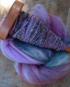Drop-spindle spun yarn. I gave it to my mom on mother's day. She loved it.