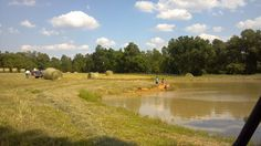 our New pond now full of water 05-2013...kids having fun....lots of frogs...we need to stock it with fish