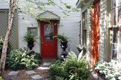 Carriage house with a red door in the Historic District