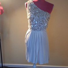 Badgley Mischka Grecian dress TO DIE FOR!!  One shoulder Badgley Mischka dress. Flowing cream colored fully lined bottom. Fully beaded top with gold and cream colored sequins, cream colored discs and clear hanging beads.  Beautiful condition. The ultimate dress for a Greek goddess! Badgley Mischka Dresses