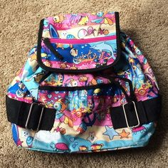Fishy Backpack This is not full size, but a smaller size perfect for travel. The top cinches and straps are adjustable. One pocket on the front, one on the top portion, and one inside. Like new condition. Brand is unknown. Accepting fair offers :) No trading. Bags Mini Bags