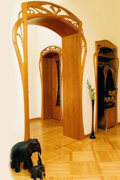 Jury Moshans' Door Arches, His Style He Calls Modernist, I Say Nouveau, Whichever Term His Hand Crafting is Fabulous. He lives and works in Latvia, the pieces he works on vary from; fireplaces, bedroom suites, kitchens, drawing rooms, screens, chess boards, doors, stairways and beyond.    Material: anegr