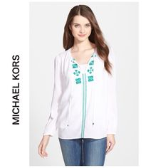 """NEW MICHAEL KORS white green peasant blouse XL 100% viscose. Has tied at neck with MK engravings in square metal bead ends. Embroidered green designs are Switzerland-inspired. Retail $99.50. Silky woven top detailed with intricate contrast embroidery at the V-neckline and hip-length hem. 27 1/2"""" length Semi-sheer; base layer recommended. MICHAEL Michael Kors Tops Blouses"""