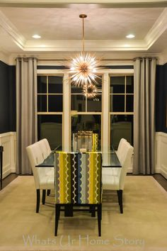 Transitional dining room -look at the awesome light fixture