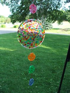 suncatcher made from melted pony beads...super easy!!! Instead of fishing line we used craft wire.