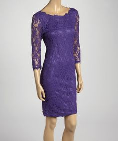 This frock is a trend-ready ticket! A lacy design is fashioned with geometric shapes, while three-quarter sleeves make for a fashionable fit. Measurements (size M): 35'' long from high point of shoulder to hem55% nylon / 45% rayonMachine wash; hang dryImported
